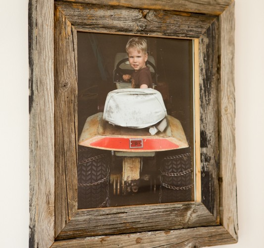 Picture frame made from re-purposed pine 2x4 material that was previously used in a garage storage unit. Approximate size: 20x30