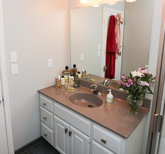 The repainted vanity with updated counter top and hardware looks brand new!