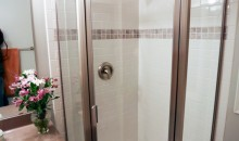 Beautiful, new corner shower unit and custom tile